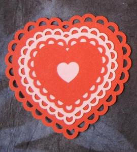 pink-red laser cut hearts - closeup