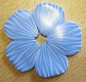 dremel buffed shiny polymer clay flower