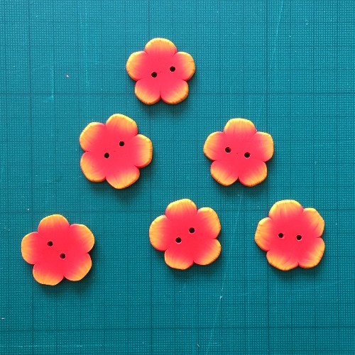 finished set of polymer clay flower buttons