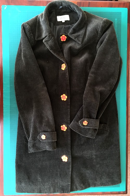 coat with handmade polymer clay buttons